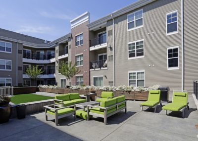 Courtyard with comfortable seating at The Station at Lyndhurst apartments