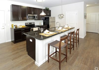 Apartment kitchens with espresso cabinetry at The Station at Lyndhurst