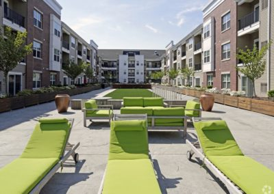 lounge chairs in the apartment courtyard at The Station at Lyndhurst